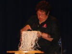 Kahu Te Kanawa demonstrating tāniko (finger weaving). Photo Credit: Genevieve Neilson