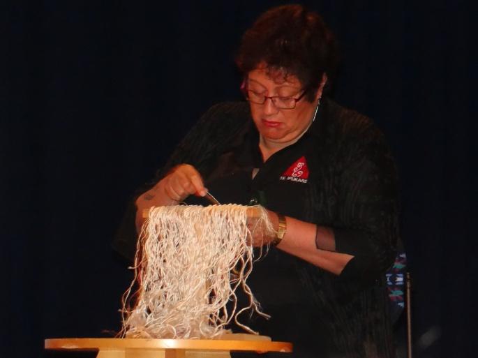 Kahu Te Kanawa demonstrating tāniko (finger weaving). Photo Credit: Genevieve Neilson